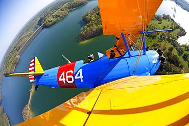 1941 Stearman biplane flying over Summersville Lake near Fayetteville, WV
