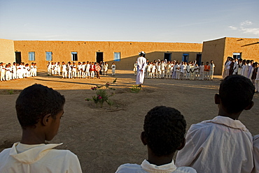 Pupils gather a school courtyard before the lessons start in Sudan.