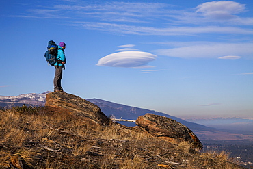 Woman standing on rock in Bitteroot Valley, Montana