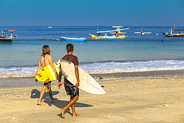 Surfers on a beach,Bali,Indonesia.