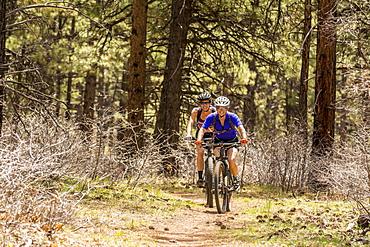 Two women mountain biking on the Boggy Draw Trail near Dolores, Colorado.