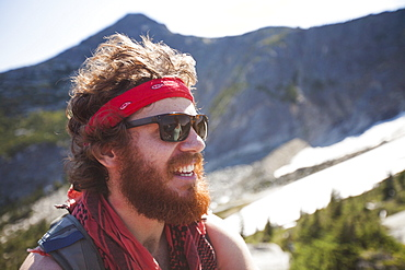 Portrait of Evan Howard, a climber and explorer, wearing a bandana and sporting a thick beard.