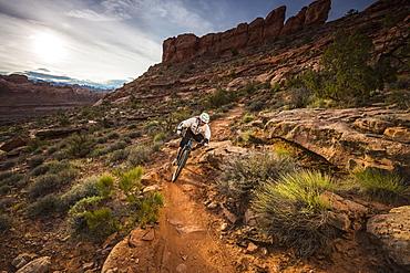 A man mountain biking on the Hymasa trail, Moab, Utah.