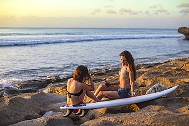 Surfer girls at the beach.