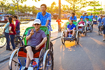 Tourists on a Cyclo tour of Hoi An Ancient Town, Hoi an, Quang Nam Province, Vietnam