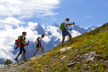 Three participants of the UTMB are running in the hills of Chamonix. The famous peaks of the Mont Blanc range are in the background. The Ultra-Trail du Mont-Blanc (also referred to as UTMB) is a single-stage mountain ultramarathon. It takes place once a year in the Alps, across France, Italy and Switzerland. The distance is approximately 166 kilometres (103 mi), with a total elevation gain of around 9,600 m. It is widely regarded as one of the most difficult foot races in Europe. It's certainly one of the largest with over two thousand starters. The combined participation in all of the events is approaching 10 thousand runners. While the best runners complete the loop in slightly more than 20 hours, most runners take 30 to 45 hours to reach the finish line.
