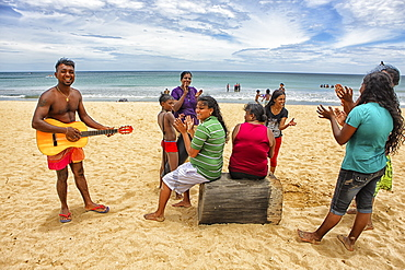 Sri Lankans singing in Nilaveli Beach. Trincomalee. Sri Lanka