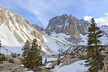 Temple Crag looms over frozen First Lake in the Eastern SIerra Nevada, California.