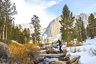 Crossing Big Pine Creek North Fork in John Muir Wilderness, Eastern Sierra Nevada, California.