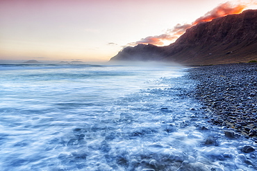 Playa de Famara risco de famara beach Mountain sand rocks reflection Lanzarote Canary Islands Spain