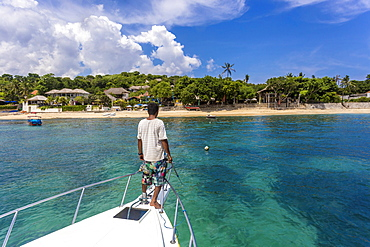 Asian man on a yacht at ocean near Nusa Lembongan island,Bali,Indonesia.