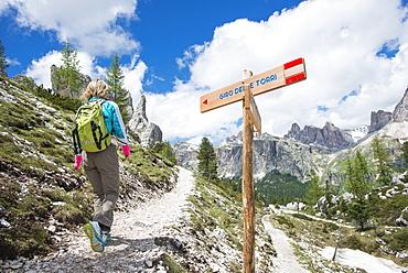 Female Hiker At Cinque Torri Area In Dolomites, Italy