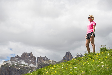 A Woman Trail Running At The Cinque Torri Area In The Dolomites, Italy