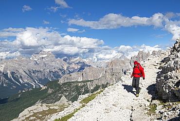 A Man Hiking From Rifugio Nuvaulau To Rifugio Averau