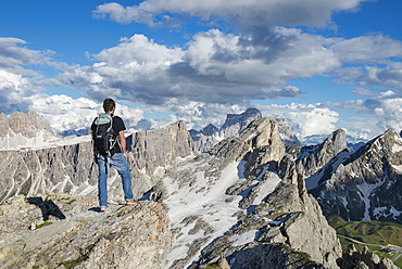A Man Standing At The Top Of Nuvolau In The Dolomites, Italy