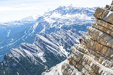 Man Climbing At The Via Ferrata Ivano Dibona In Dolomites, Italy