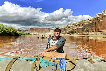 Man Canoeing After A Flood On The Green River In Canyonlands National Park, Utah