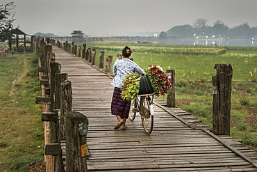 A Local Flower Seller With Bike At The U Bein Bridge In Amarapura, Myanmar