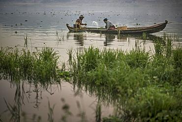 Fishermen In Their Boat At Taungthaman Lake In Amarapura, Myanmar