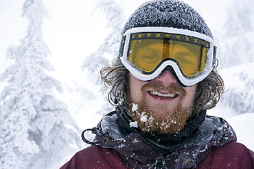 Portrait Of Male Snowboarder During A Snowstorm