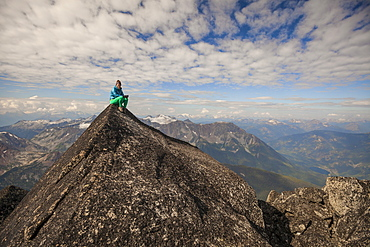 Female Climber Sitting On Top Of Mount Marriott