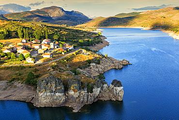 Camporredondo Reservoir And The Village Of Alba De Los Cardanos In Palencia Province, Northern Spain