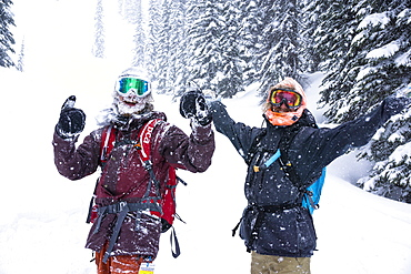 Two Happy Friends Enjoying In Snowy Region During Snow In Revelstoke, British Columbia, Canada