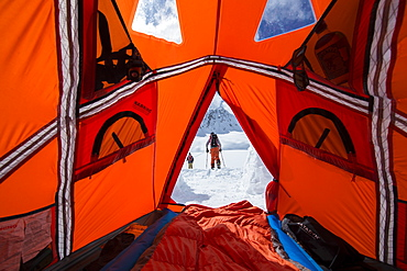 Snowboarders Touring Out Of Base Camp In Canada