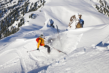 A Backcountry Skier Wipes Out While Ski Touring In Garibaldi Provincial Park