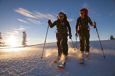 Two People Ski Touring Through Fresh Snow In Garibaldi Provincial Park, Canada