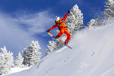 Person Snowboarding On Snowy Landscape In Chamonix Valley