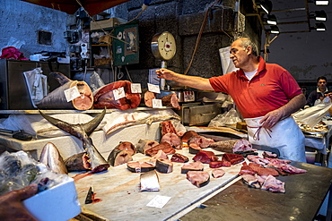 A Fishmonger Weighing Fish For A Customer In Sicily, Catania