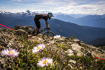 A Mountain Biker Riding On Rocky Landscape In Whistler, British Columbia, Usa