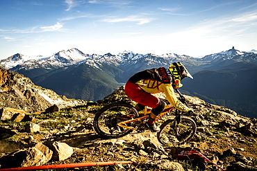Person Mountain Biking On Rocky Landscape In Whistler, British Columbia, Usa