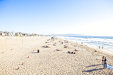 High Angle View Of Swimmers And Sunbathers At Manhattan Beach