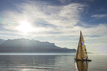 A Sailboat Gliding Over Lake Geneva On A Sunny Day