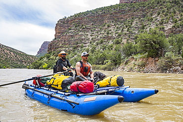 Two Men Rafting In Yampa And Green Rivers Through Dinosaur National Monument