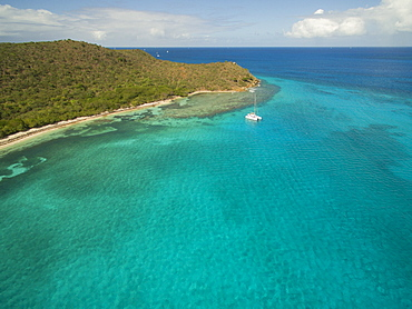 A Sailboat Rests In The Clear Waters Near Prickly Pear Island In The British Virgin Islands