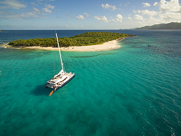 A Catamaran Rests In The Clear Waters Near Sandy Cay In The British Virgin Islands