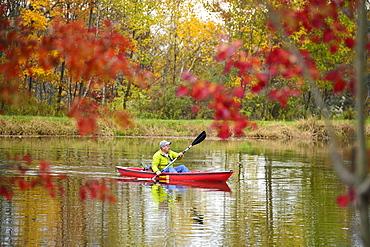 Man Kayaking On Lake