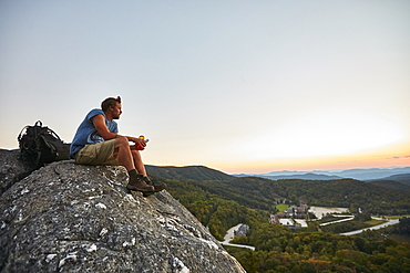 A Man Sits On A Rock Enjoying The Sunset Along The Appalachian Trail