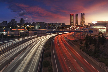 High Angle View Of Trail Light Running On Highway In Madrid City