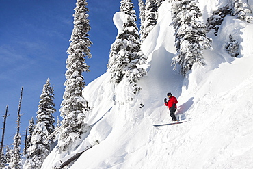 Male Skier Stops To Look Around While Skiing In North Bowl Chute In Whitefish, Montana