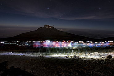 Climbers Trace Ghostly Shapes Through The Starry Night On Mount Kilimanjaro's Rongai Route