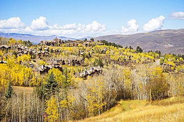 House And Golden Fall Foliage On The Mountain Side Of Bachelor Gulch, Colorado