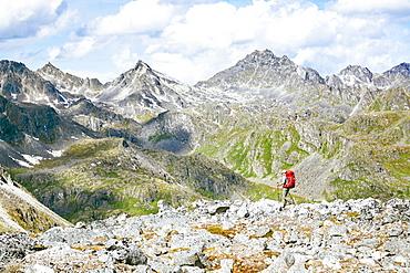 A Woman Hiking On Rocky Landscape In Talkeetna Range In Alaska, Usa