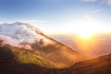 The Orange Sun Showers The Banks Of Pacaya Volcano At Pacaya National Park, Escuintla, Guatemala