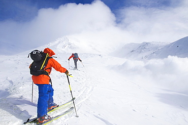 Two Backcountry Skiers Are Ascending To The Highest Mountain Of Hokkaido