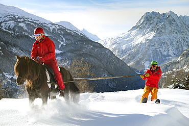 Skijoring Is A Winter Sport Where A Person On Skis Is Pulled By A Horse