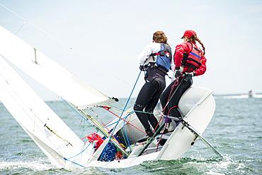 Two Teenage Girls Sailing Boat At Narragansett Bay As Part Of Junior Sailing Program